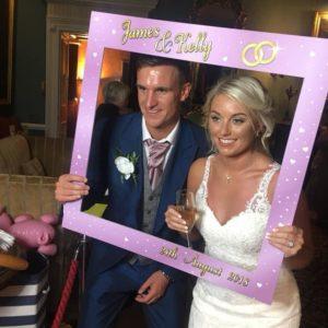 Wedding couple posing for Magic Mirror Photo Booth